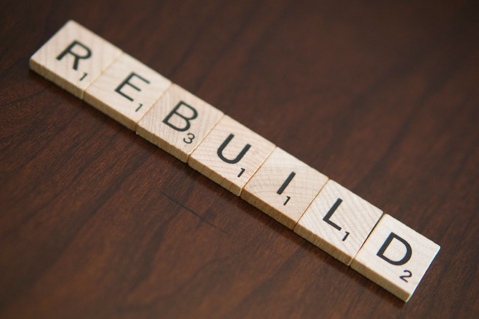 Tiles with alphabets joined to make the word Rebuild